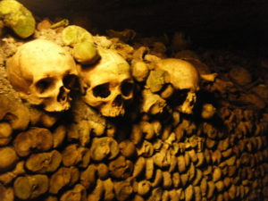 Beneath the enchanting streets of Paris dwells the crumbling bones of those passed over... the Catacombs